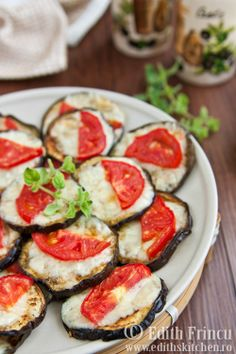 "The website is in Romanian, but Google Chrome translated it for me (to ""Plants with Baked Mozzarella""). Pretty sure that's eggplant. Yum."