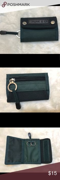 Trunk & Company green sports coin purse/key chain NWOT in excellent condition. Hunter green  canvas like fabric material with black mesh compartment to hold ID's, cash and credit card. Key chain in the center. Coin purse at the back. Velcro front closure and zipper on back. Great quality!   🌲Trunk and Company is a product of Samsonite Europe.🌲 Trunk and Company Bags Wallets
