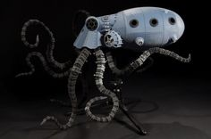 Insanely awesome steampunk 3D printed octopus vehicle!  For the last several weeks I have talked about different things one can build with a 3D printer. The items I printed pale in comparison to this work of art by Sean Charlesworth who designed and printed this robotic beauty over the course of two semesters for his thesis in 3D modeling and animation.