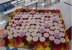 Ping Pong Toss game - for the Back to School Carnival.......We could put little Oriental Trading goodies in each cup and they get that prize!