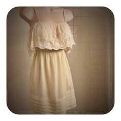Cream C. Luce Lace Top Split Sleeve Pleated Dress Fun and flirty , this above the knee, cream colored scoop neck dress by C. Luce features a lace overhang top with spaghetti straps and lace split sleeves. The dress has a cinched waist, with loops for a belt or sash, and flared skirt below the higher flattering waistline. The bottom of the skirt is  detailed with horizontal pleats/ layers. This dress is pretty and feminine and in excellent preloved condition. There is no belt included with…