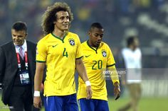 David Luiz and Robinho of Brazil of Brazil leave the field after the 2015 Copa America Chile Group C match between Brazil and Venezuela at Monumental David Arellano Stadium on June 21, 2015 in Santiago, Chile.