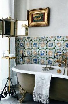 Boho chic bathroom with clawfoot bathtub and gold details