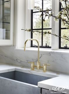 White marble kitchen counter and backsplash with brass gooseneck faucet and . White Marble Kitchen Counter and Backsplash with Brass Gooseneck Faucet and Black Trimmed Windows by Amy Kartheiser Design, Kitchen Marble, Kitchen Interior, Kitchen Inspirations, Home Decor Kitchen, Home, Kitchen Remodel, House Interior, Kitchen Dining Room, Marble Kitchen Counters