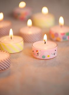 Cool idea: use for candles that smell like deserts and have the edge look like cupcake liners...Take your table-top tea lights from boring to bodacious with a small strip of washi tape around the edges. // Glitter Guide
