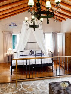 Stone House situated between 2 beaches i.e. Glyfada & Monodendri with surrounding of olive grove. #travel #holiday #house #rentalvillas #hotel Beach Villa, Porch Swing, Outdoor Furniture, Outdoor Decor, Villas, Beaches, Stone, Holiday, House