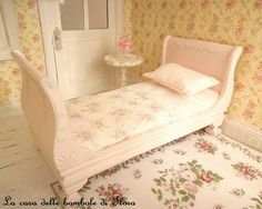 bed and fabric and wallpaper, door