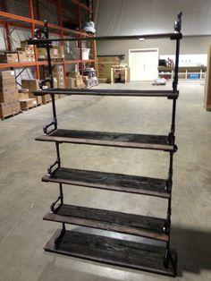 The ex's shoe shelves. Pallet shelves 1/2 steel pipe brackets