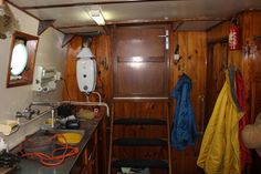 Aft Galley, steps and door to the deck. The door on the right is to the workroom and forward cabins.