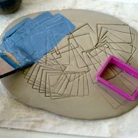Slip Inlay: transfer design onto wet clay, cover with wax, incise lines (drawing) into clay, paint over with underglaze, wipe of excess underglaze.