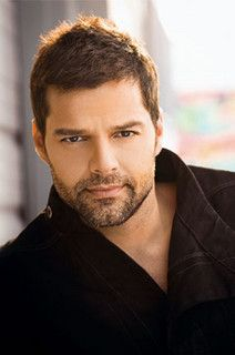 Ricky Martin; I have always been a huge Ricky Martin fan.. I used to have a sleep shirt with his face on it. He is a QT!