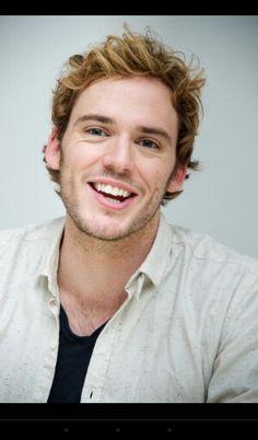 Sam Claflin has the cutest grin!
