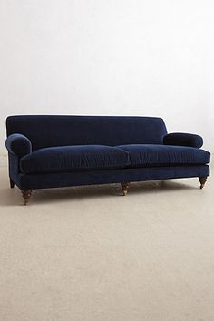 love this blue velvet sofa. Could possibly work with your brown arm chairs if you wanted a bold pop of color. Also with pillows and a throw to break up all that blue it won't seem as intense. Though if you go this dark I think the walls need to be dark. Maybe a dark grey in the living room?
