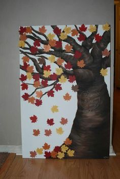 This was the guest book that we used in our wedding. We got a leaf shaped punch and as people came in they signed and we placed them on the beautiful tree my aunt painted for us!