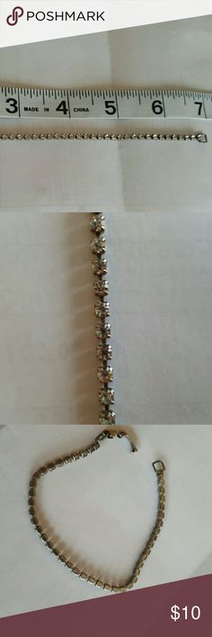REDUCED: Vintage Rhinestone Bracelet Pretty rhinestone bracelet. Very delicate but classy looking. 7 in Length, might be more suitable for a child or teen. Very good condition.  No designer signature. Jewelry Bracelets