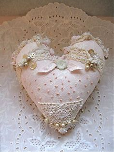 Pretty pink cloth heart on lace