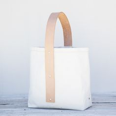 """Artist : Roberta Rennie  A modern bucket bag, constructed of heavyweight100% cotton canvas and with  an elegantvegetable tanned leather loop strap.RENNIE bags are designed  with every day use in mind.  The bags are designed with with a minimal  silhouette and aesthetic to keep this """"everyda"""
