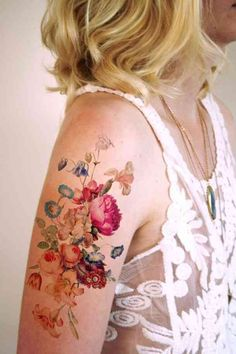 Colorful wildflowers upper arm tattoo. Love the colors and level of transparency