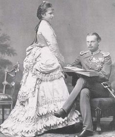 Archduchess Gisela wears a first bustle era dress with a frilly skirt in this 1872 photo.