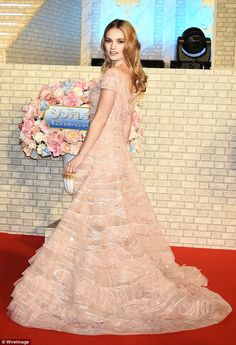 Stunning: Lily James looked effortlessly regal when she attended Cinderella's Asian premiere in Tokyo on April 7, 2015