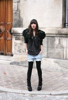 Rock Chic Blogger Style - Le Blog De Betty: Black Moto Jacket, gray tee, feather shawl, shorts, black leggings with black boots