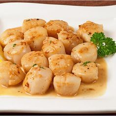 Garlic Lemon Scallops, from our recipe manual. **Makes 4 servings** 14 oz. bay or sea scallops rinsed and drained, 1/4 cup lemon juice, 2 cloves garlic (minced), lemon pepper (to taste) Directions: Preheat oven to 350. Pat scallops dry with paper towels & place in casserole dish. Bake scallops for 5 minutes. In small bowl, combine lemon juice and garlic. Remove scallops from oven. Spoon lemon/garlic mixture over scallops & sprinkle with lemon pepper. Return scallops to oven, bake until firm.