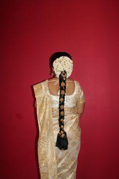 Hindu Bride Hairstyle by Dazzling Darlings London. #hairstyle #traditionalhairstyle #bridalhairstyle #tamilhindubride