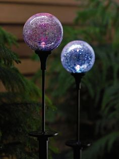 Color-changing Solar Northern Lights Spheres bring a little magic to your garden.