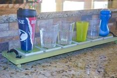 Assign everyone a cup in your house that they will use for the day. Store on a coaster when not in use.