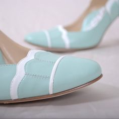 "ShopHeyLady.com  LOVE these two sisters who design comfy and beautiful wedding shoes!    3"" heel Audrey Hepburn a la ""Breakfast At Tiffanys""-inspired Robins Egg blue scalloped toe and heel pump  Each pair of shoes features:  • Invisible ""wing"" arch support   • Dancer's fit toe box   • Full insole of shock-absorbent memory foam   • Balanced and centered heel   • Soft Italian kid leather lining   • 100% silk satin or leather uppers"