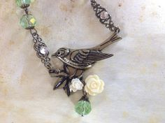 A personal favorite from my Etsy shop https://www.etsy.com/listing/461885746/bird-necklace-crystal-necklace-hand