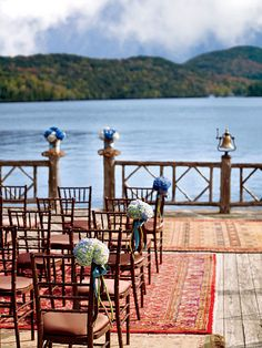 Brides.com: Classic Fall Wedding Style. Well-chosen accents complement the Lake Placid setting: Hydrangeas echo the water and sky, rugs make the site homey, and the bell ensures a festive ending. (Ring it to announce your new marriage!)  Bell, brassbell.com. Chairs and cushions, Clifton Park Rental Center. Rugs, Lake Placid Lodge. Flowers, Ann Graham for Lake Placid Lodge.