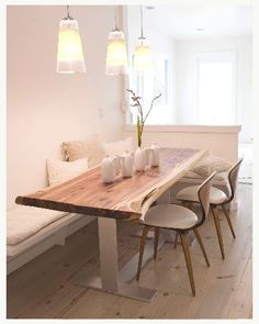 dining nook with banquet and rustic light wood table are chairs comfortable