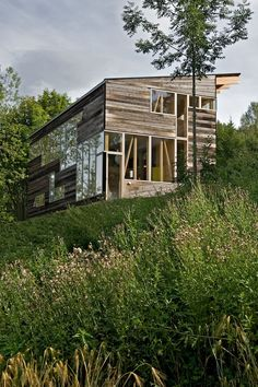 Norwegian farmhouse in salvaged barn wood; Jarmund/Vigsnæs AS Arkitekter MNAL
