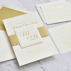 Luxurious layers come together to form one of the most beautiful wedding invitations we offer! A gold glitter belly band wraps around the ecru textured invitation and is finished with a coordinating ecru textured tag featuring your choice of a black matte or blush shimmer backer. All wording is stamped in shimmering gold foil. This invitation is dressed to impress!