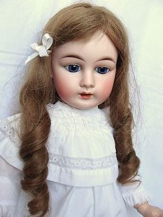 Pretty Vintage Doll with curls.