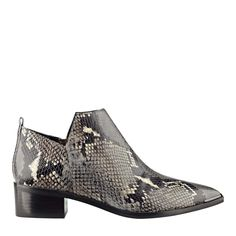 Low cut shaft ankle bootie with angular cut out and modest block heel makes this bootie a fall standout.