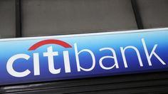 Banks. Market rigging. Fines.   A Citibank sign hangs above a branch office, Thursday, Jan. 15, 2015, in New York. Citigroup said its fourth-quarter profit dropped 86 percent after incurring large legal and restructuring charges. (AP Photo/Mark Lennihan)