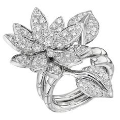 "Lotus between-the-finger ring, accented by round brilliant cut diamonds weighing approximately 2.30 total carats, mounted in 18k white gold, signed ""VCA"" for Van Cleef & Arpels."