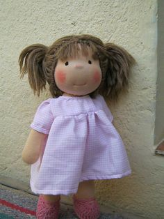 This doll looks just like ANNA!!!!! This is the face I'm going to try. Hopefully anyway. :D