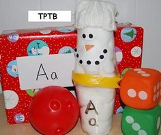 """Snowman"" Bowling Craft for use with Literacy/Math Games"