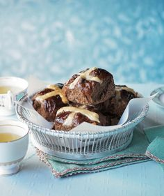 Spiced chocolate and orange hot cross buns recipe. Hot cross buns are traditionally eaten on Good Friday, hot from the oven with lashings of butter. Try this chocolate and orange hot cross bun recipe for a bit of variation this Easter. Cross Buns Recipe, Bun Recipe, Kitchen Recipes, Baking Recipes, Chocolate Hot Cross Buns, Delicious Magazine, Easter Recipes, Easter Ideas, Tray Bakes