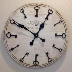 DIY clocks - using old keys!!! really like this!! just need to find some super cool keys!