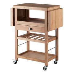 Everything you need to expand your kitchen, dining, or entertaining workspace is here in the Barton Kitchen Cart. Made of eco-friendly bamboo, this versatile space-saver has a wide range of uses. Two drop leaves expand the table top to create a large surface for chopping vegetables, tossing a salad, or for use as a serving area. Store wine bottles on the built-in wine rack and use the other shelves for glassware, dishes, and more. A unit-wide drawer and a removable serving tray complete…