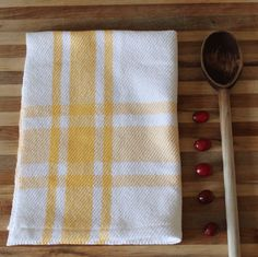 Handwoven tea towel / sunny yellow white farmhouse plaid / kitchen towel handmade by NutfieldWeaver. $20.00, via Etsy.