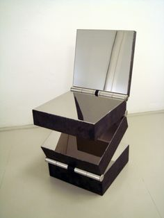 Boxes in Four Movements, circa 2007 by Ron Arad http://www.artnet.com/auctions/artists/ron-arad/box-in-four-movements