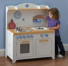 All Play Kitchens - Hideaway Country Play Kitchen, $159.99 (http://allplaykitchens.com/hideaway-country-play-kitchen/)