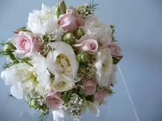 Beautiful wedding bouquet of lightly scented cream peonies, pale pink 'Sweet Avalanche' roses, white wax flowers and herbs. Prom Flowers, Wax Flowers, Wedding Flowers, Rose Wedding Bouquet, Rose Bouquet, White Wax Flower, Summer Wedding Colors, Flower Arrangements, Floral Arrangement