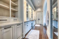 2904 Morrison St Houston, TX 77009: Photo Impressive master bath with considerable built-in storage, marble countertops, clawfoot tub, walk-in shower, and double sinks plus additional vanity space.