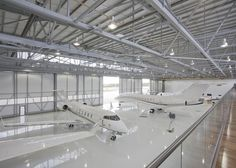 All white Private Jet Hangar, Biggin Hill airport, UK _ by architects SHH _